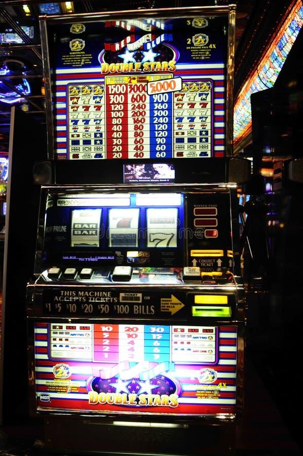 Machine à sous - casino - jeux d'argent liquide - dollars image libre de droits
