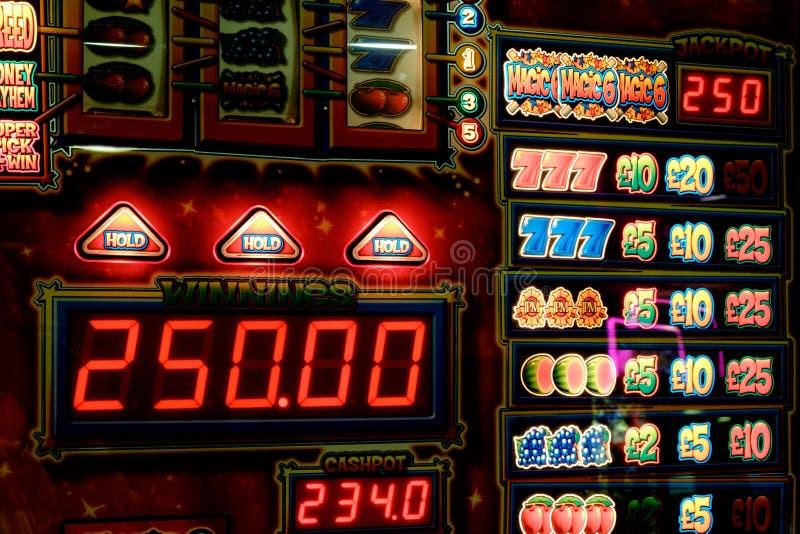 Machine à sous pour jouer, devise BRITANNIQUE photos stock