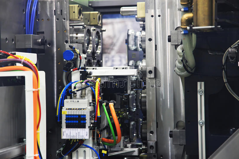 Machine de moulage par injection image stock