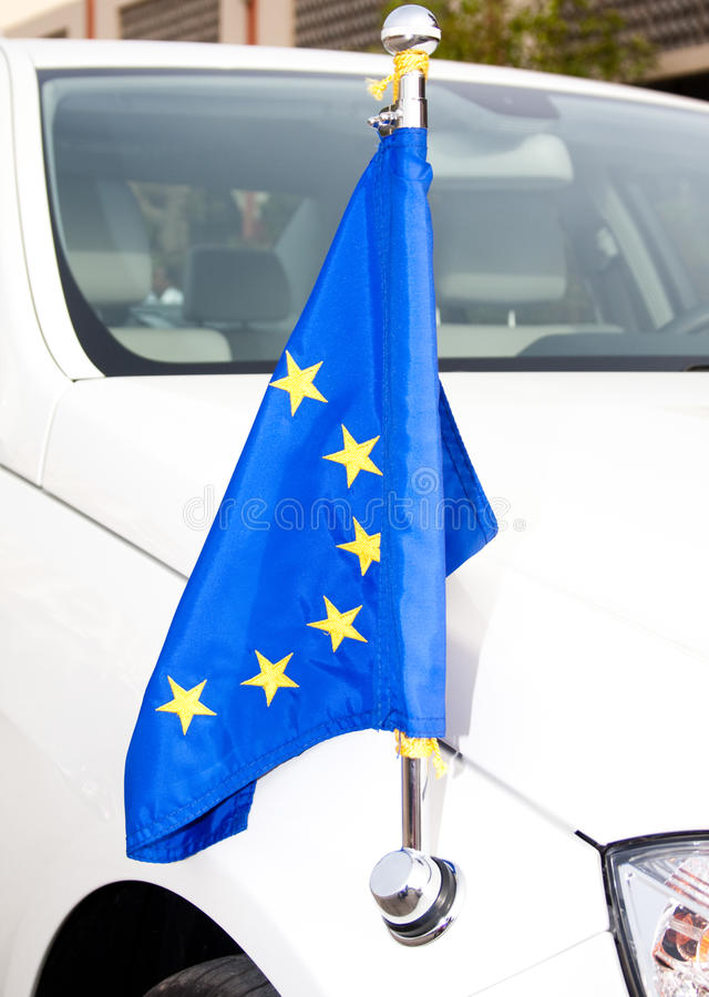 Car of Diplomatic Corps EU with flag. The machine of Diplomatic Corps of the European Union with the flag royalty free stock photography