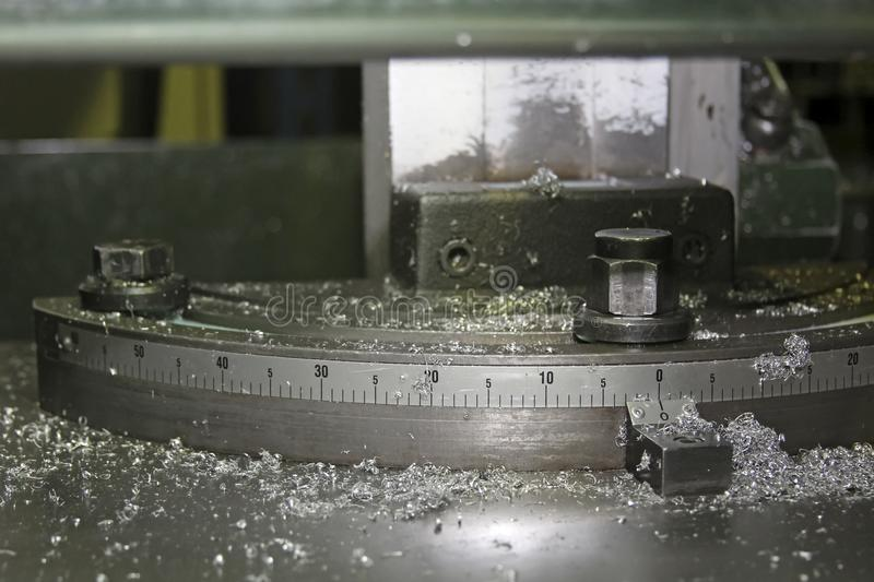 Machine element with measuring scale and metal shavings royalty free stock photo