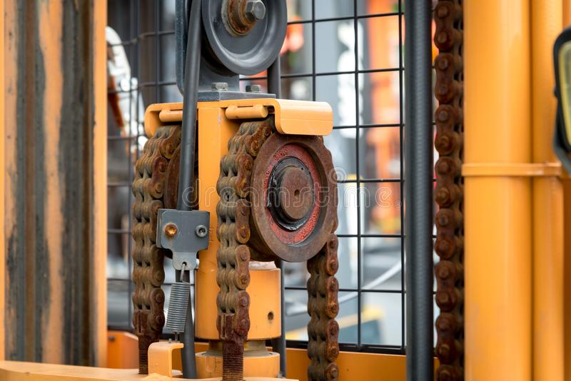 Machine engine chain with cog wheel part of forklift truck. Close up of machine engine chain with cog wheel part of forklift truck royalty free stock photography