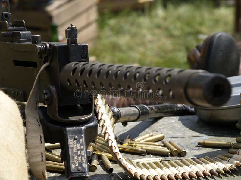 Machine-gun. Soldiers in scene, focus in bullets royalty free stock photos
