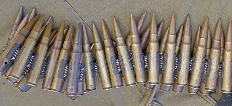 Machine gun ammo. On a piece of tarp royalty free stock photos