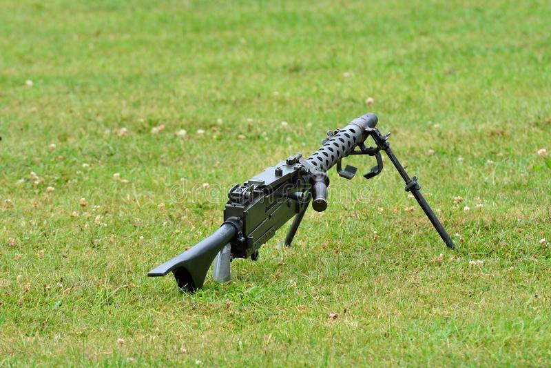 Machine gun lying on ground stock photos