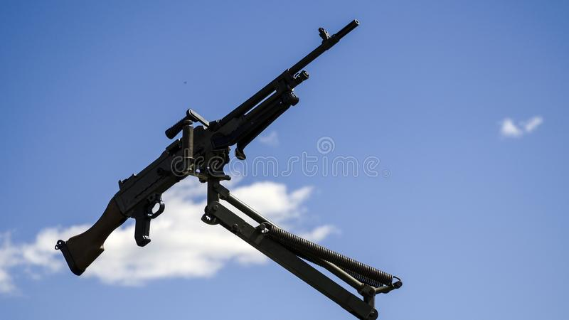 Machine gun mounted on military vehicle. Machine gun mounted on a military vehicle, army gun isolated on the blue sky background royalty free stock photos