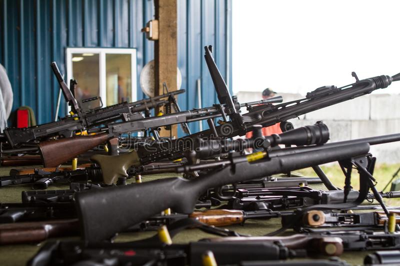 Machine Gune Table. A table with numerous machine guns and rifles at a firing range royalty free stock photography