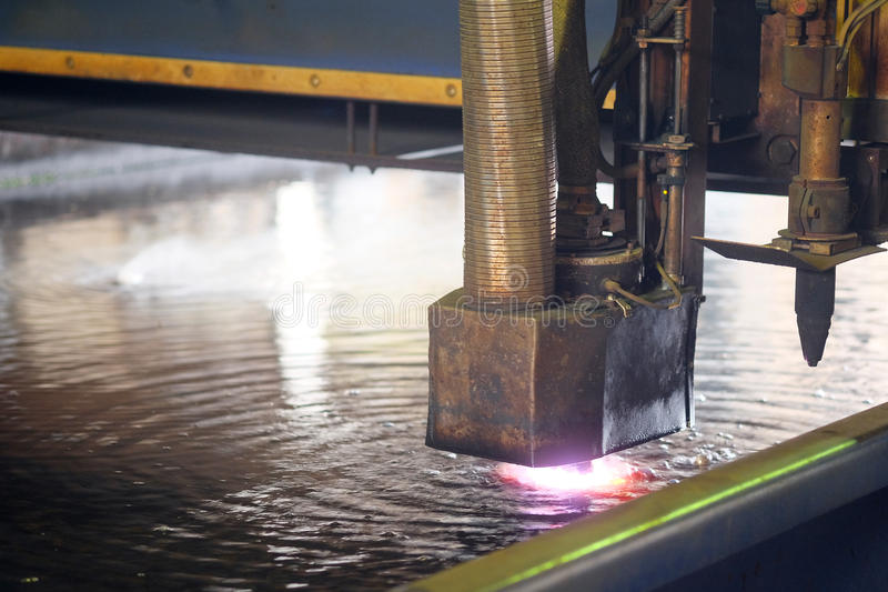 Machine for the laser cutting metal in water stock photo