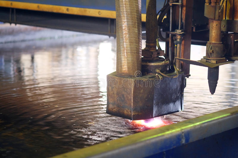 Machine for the laser cutting metal in water royalty free stock images