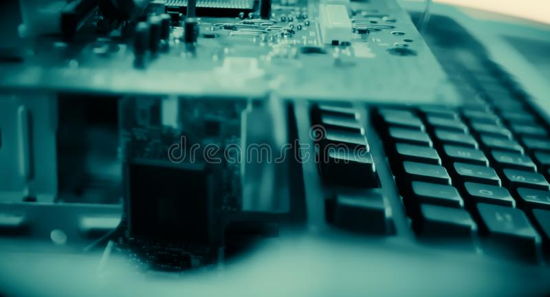 Machine learning artificial intelligence conception. Computer keyboard and hardware, technology dark green background royalty free stock images