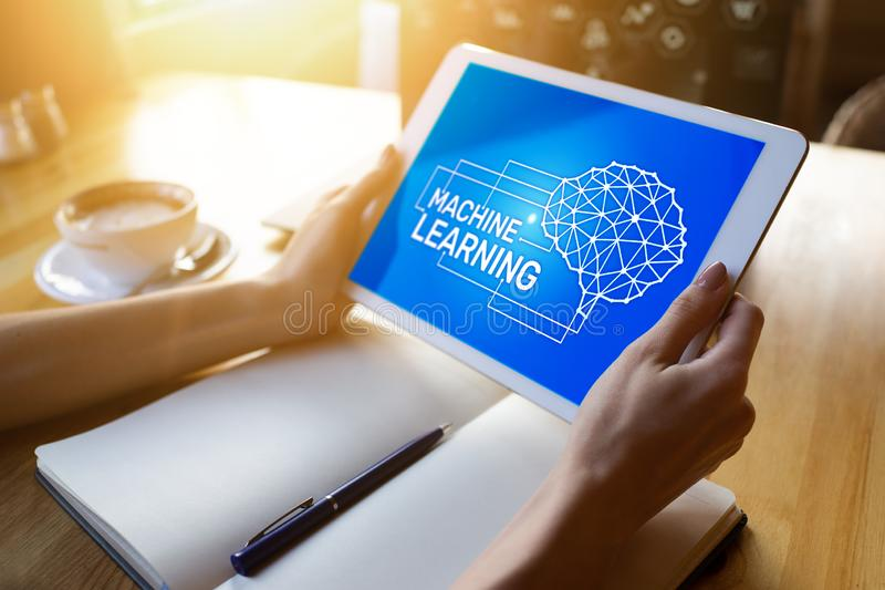 Machine learning, artificial intelligence and smart technology concept on device screen. Machine learning, artificial intelligence and smart technology concept stock photos