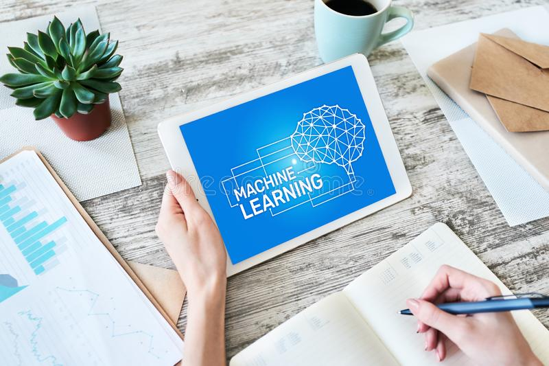 Machine learning, artificial intelligence and smart technology concept on device screen. Machine learning, artificial intelligence and smart technology concept stock photo