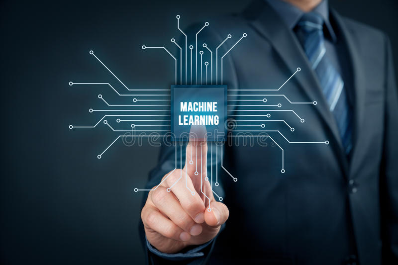 Machine learning concept. Machine learning data analysis concept. Businessman or programmer with abstract symbol of a chip with text machine learning connected stock image