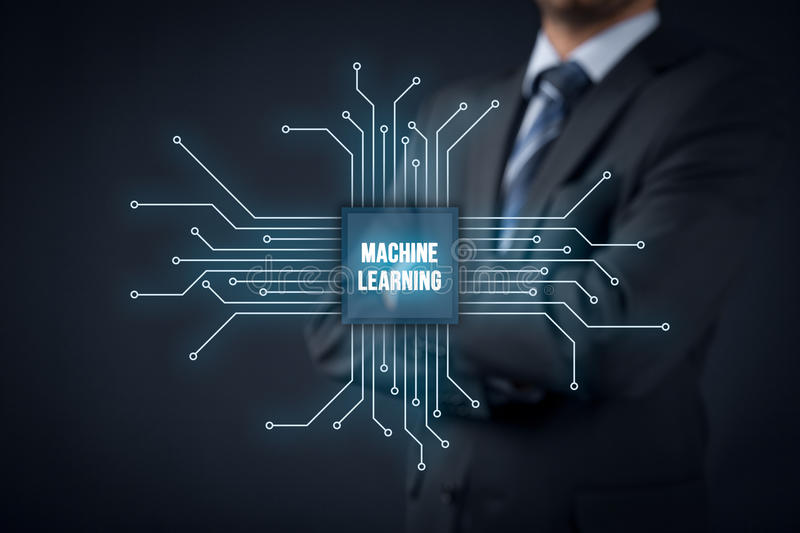 Machine learning concept. Machine learning data analysis concept. Businessman or programmer with abstract symbol of a chip with text machine learning connected stock photography