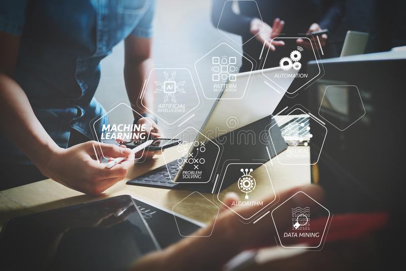 StartUp Programming Team. Website designer working digital table. Machine learning technology diagram with artificial intelligence (AI),neural network,automation royalty free stock photo