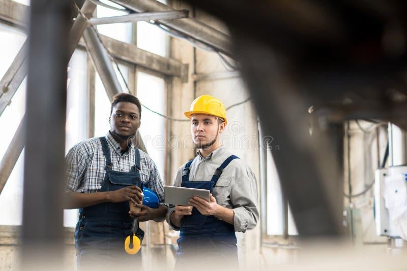 Machine Operators Taking Break from Work stock photography