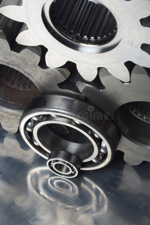 Machine parts connection. Cogs, gears and ball-bearings from elevated view stock images