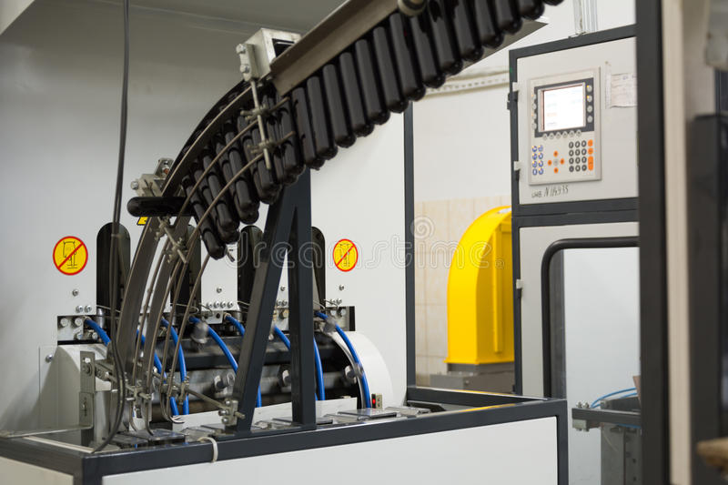 Machine for PET bottles from preforms black stock photos