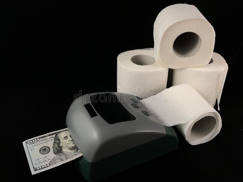 A machine for the production of dollars. Making dollars from toilet paper. Fake American money. Concept: fake dollars, money trash. Detector for checking and stock image