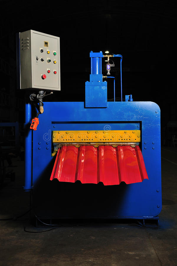 Machine for rolling steel sheet in warehouse, Cold rolled steel royalty free stock images