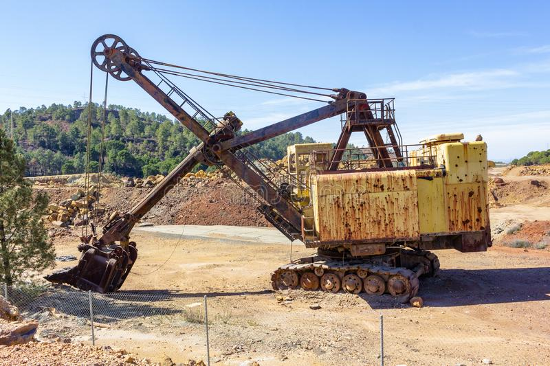 Machine scavenge in the viewpoint of Minas de Riotinto royalty free stock photography