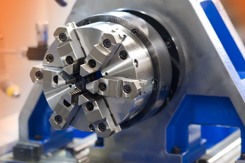 Machine shop lathe background. Industrial lathe in a hi tech machine shop stock photos