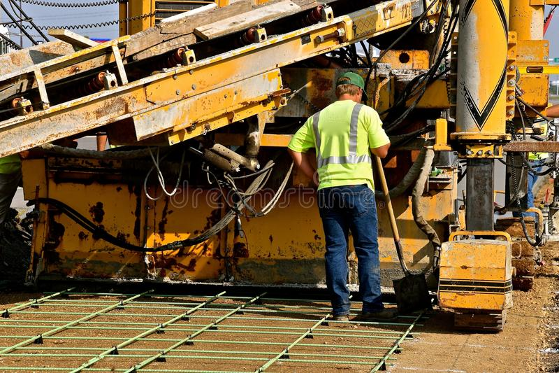Machine to lay concrete to create a new sidewalk stock photos
