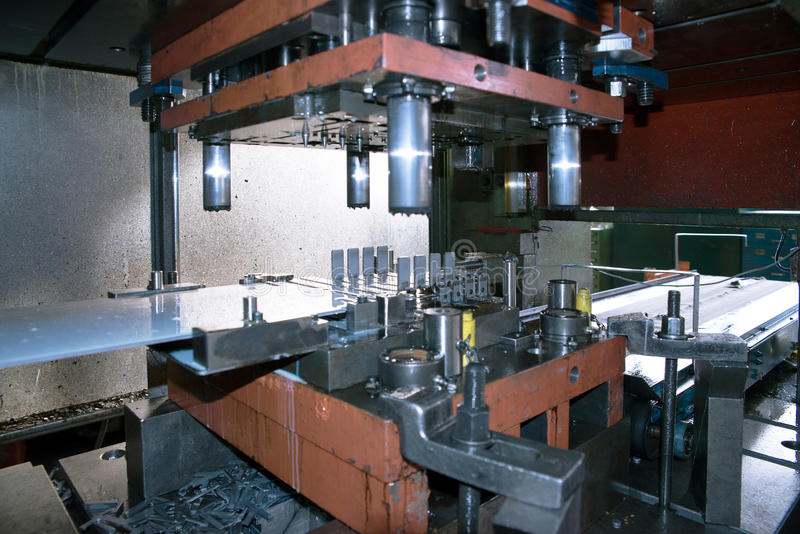 Machine tools with Computer Numerical Control (CNC). Computer Numeric Control (CNC) is the automation of machine tools that are operated by precisely programmed stock images