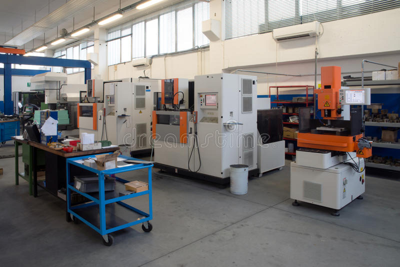 Machine tools with Computer Numerical Control (CNC). Computer Numeric Control (CNC) is the automation of machine tools that are operated by precisely programmed royalty free stock images