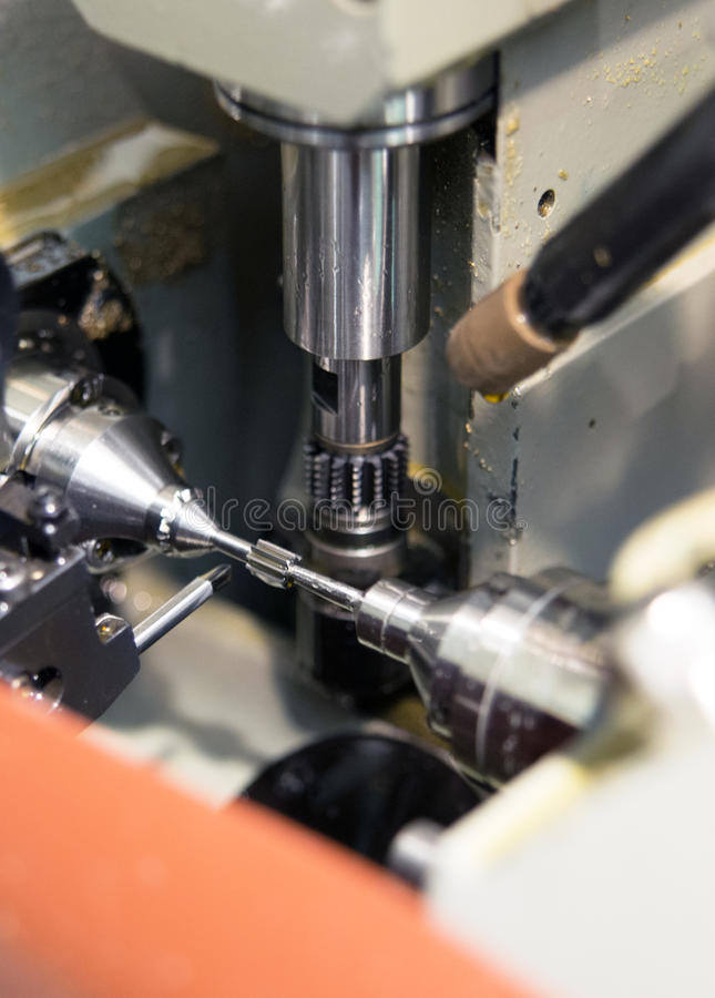 Machine tools with Computer Numerical Control (CNC). Computer Numeric Control (CNC) is the automation of machine tools that are operated by precisely programmed stock photography