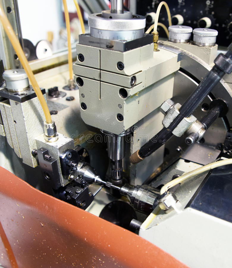 Machine tools with Computer Numerical Control (CNC). Computer Numeric Control (CNC) is the automation of machine tools that are operated by precisely programmed stock photo