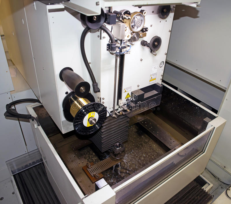 Machine tools with Computer Numerical Control (CNC). Computer Numeric Control (CNC) is the automation of machine tools that are operated by precisely programmed royalty free stock image