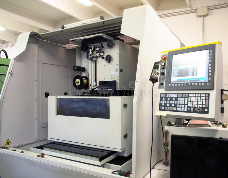 Machine tools with Computer Numerical Control (CNC). Computer Numeric Control (CNC) is the automation of machine tools that are operated by precisely programmed stock photos