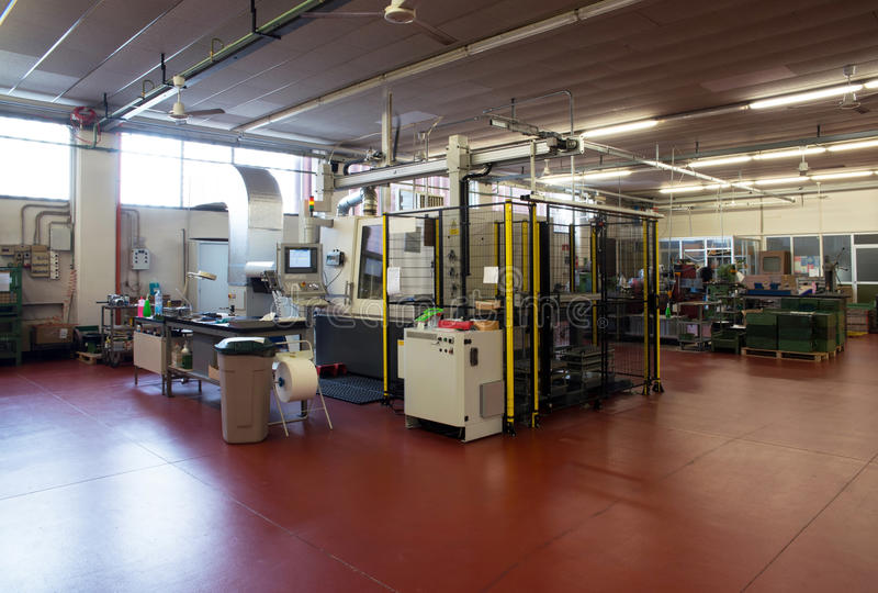 Machine tools with Computer Numerical Control (CNC). Computer Numeric Control (CNC) is the automation of machine tools that are operated by precisely programmed royalty free stock photos