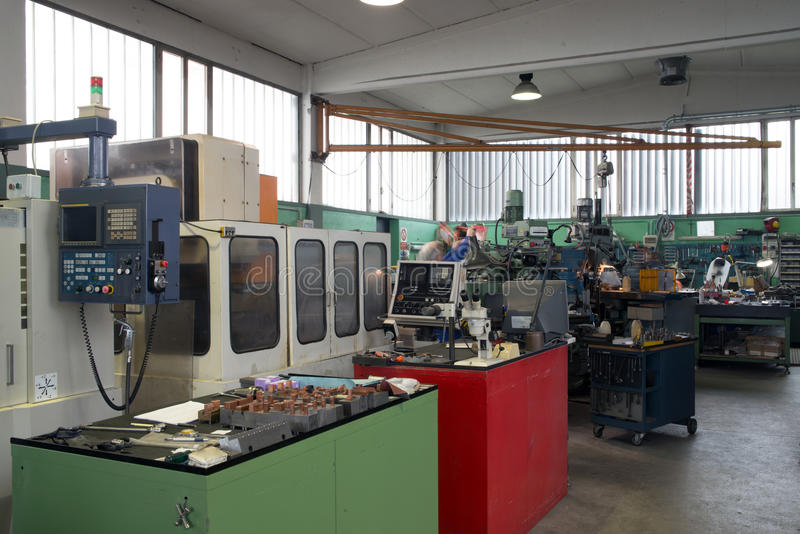 Machine tools with Computer Numerical Control (CNC). Computer Numeric Control (CNC) is the automation of machine tools that are operated by precisely programmed royalty free stock photography