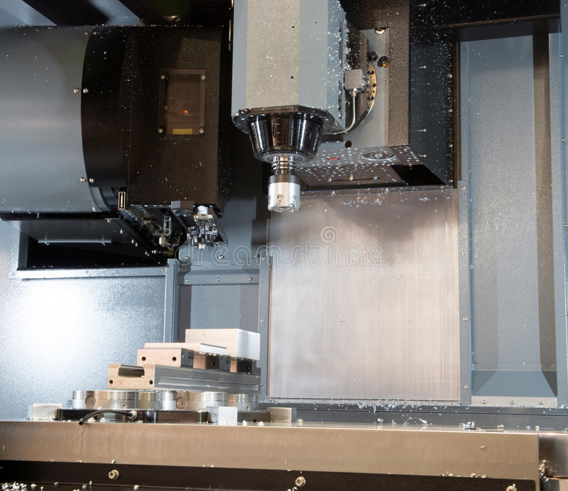 Machine tools with Computer Numerical Control (CNC). Computer Numeric Control (CNC) is the automation of machine tools that are operated by precisely programmed stock image