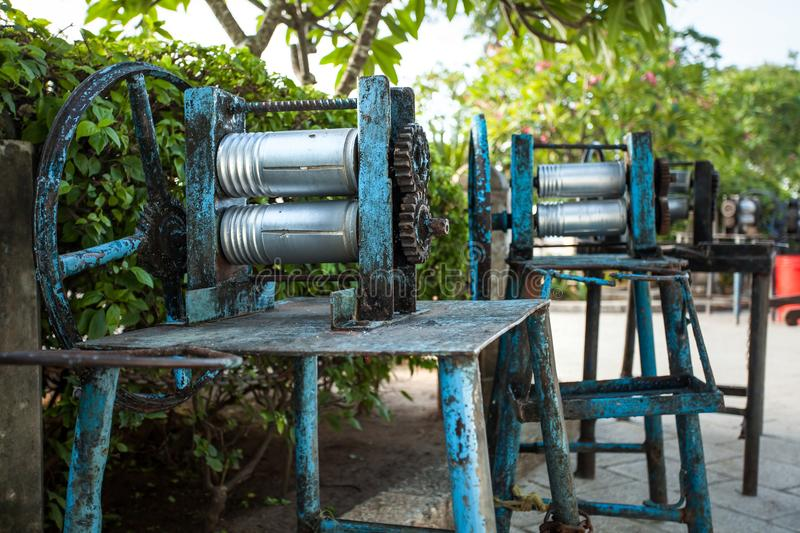 Sugar cane mangler. Machine used for crushing up sugar cane, also known as a mangler stock image