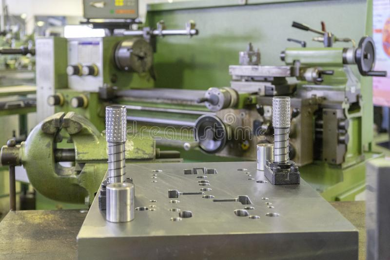 Machine workshop with lathe machine and bench vise stock images