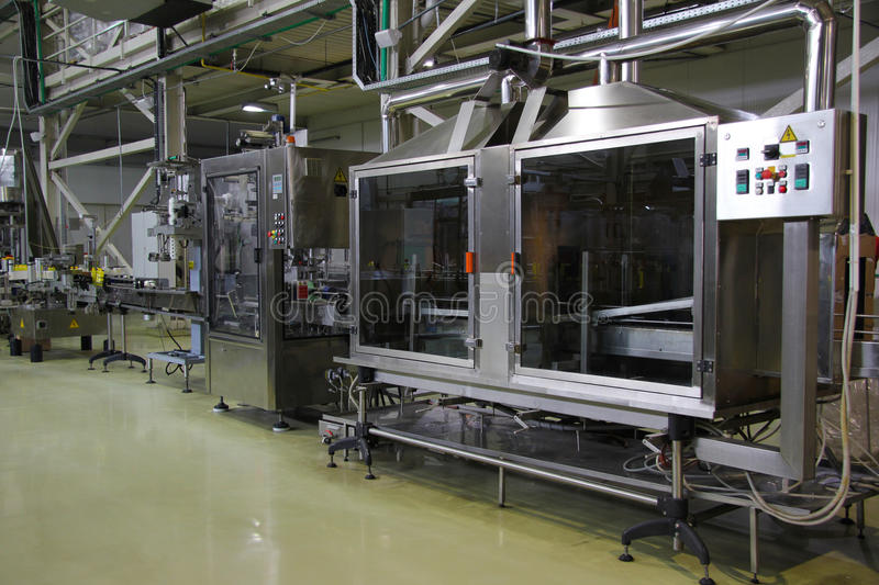 Machinery for bottling. Liquid detergent on automated production line. Machinery for bottling stock photo