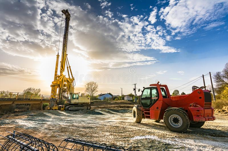 Machinery for the construction of a bridge stock photography