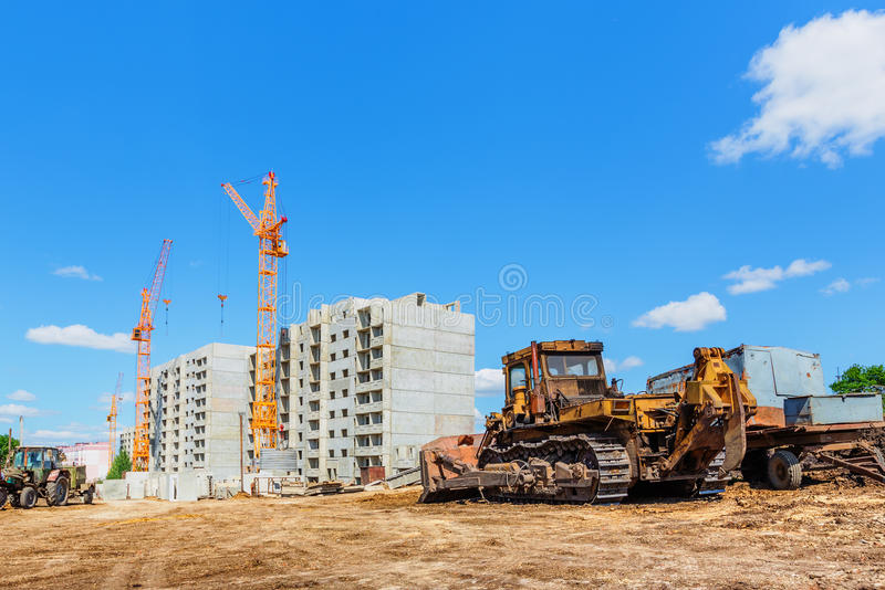 Machinery on construction site. Beneath blue cloudy sky royalty free stock image