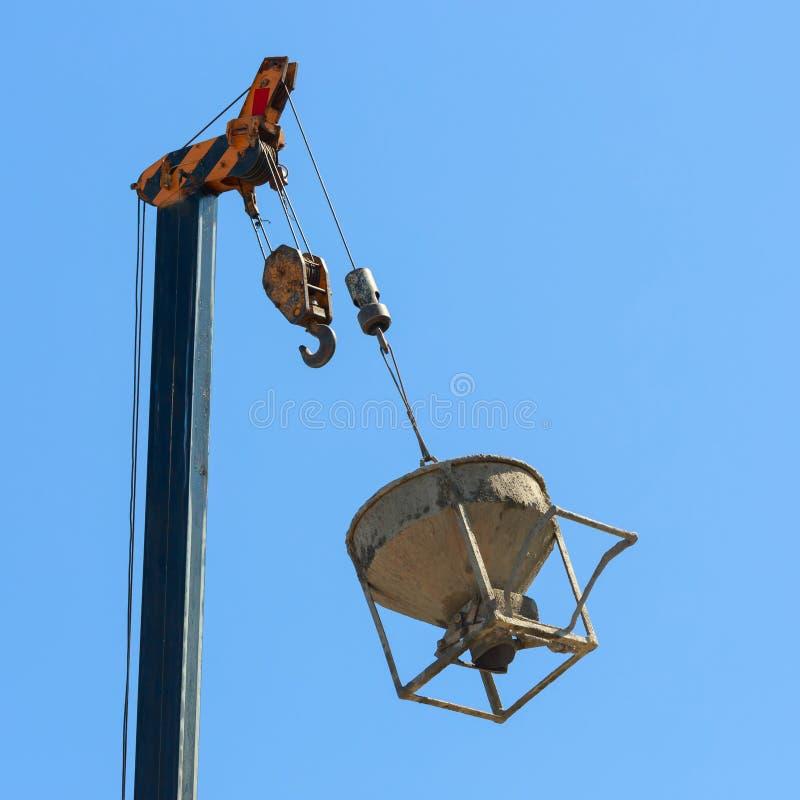 Free Machinery Crane Hoisting Cement Mortar Mixer Bucket Royalty Free Stock Image - 95487666