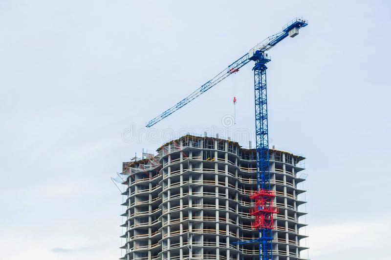 Machinery crane working in building industry. Machinery crane working in construction site building industry stock photo