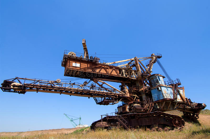 Machinery for digging pits. Photo of industrial machinery for digging pit mining of different soils royalty free stock photos