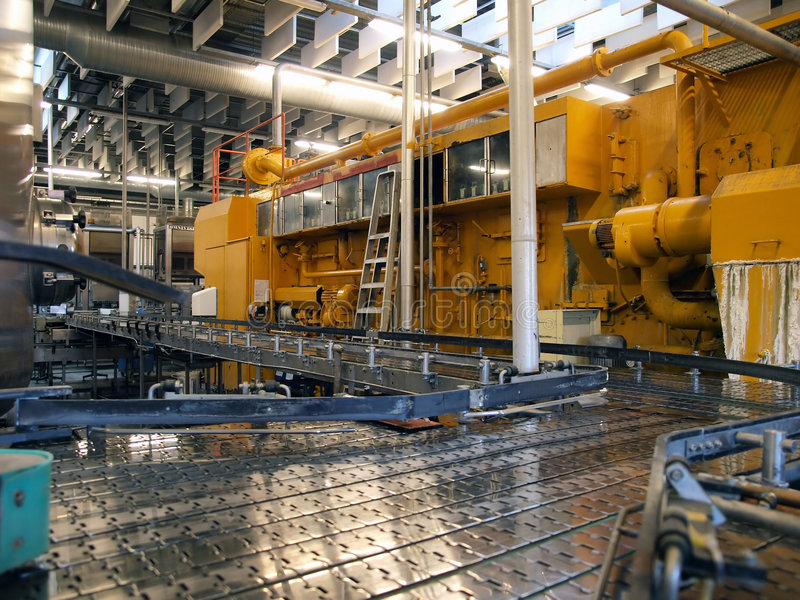 Machinery in a modern factory plant. Machinery conveyor belt in a modern factory plant stock image