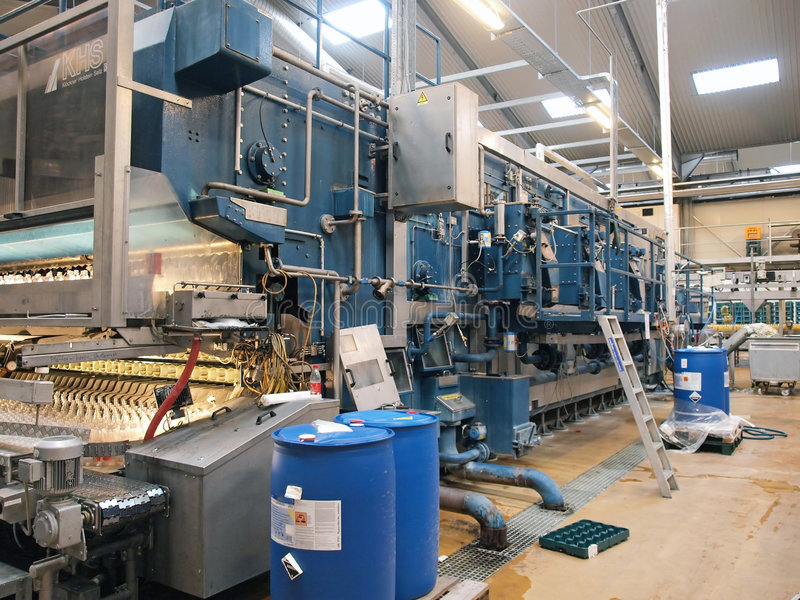 Machinery in a modern factory plant. Machinery conveyor belt in a modern factory plant stock photo