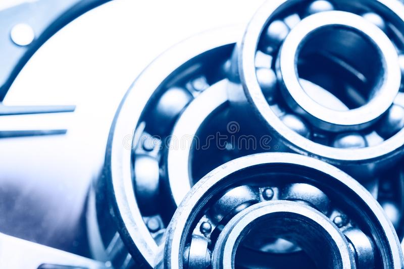 Machinery and technology background. Group of various ball bearings on hard disk drive.  stock photos