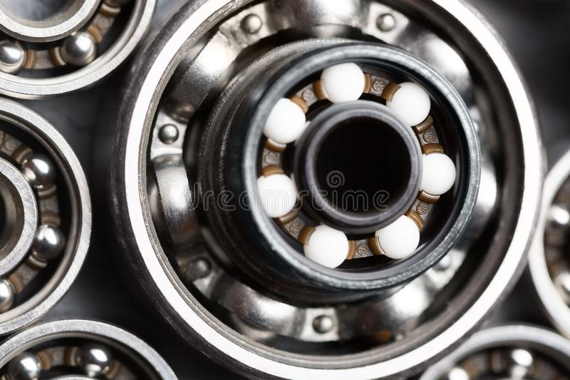 Machinery and technology industrial background. Group of various ball bearings close up.  royalty free stock photos