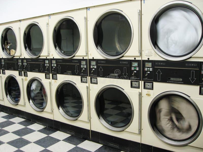 Machines de couvre-tapis de Landry photos stock