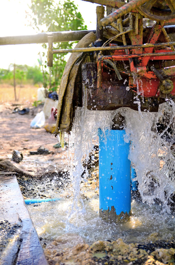 Machines are drilling artesian well. stock photography